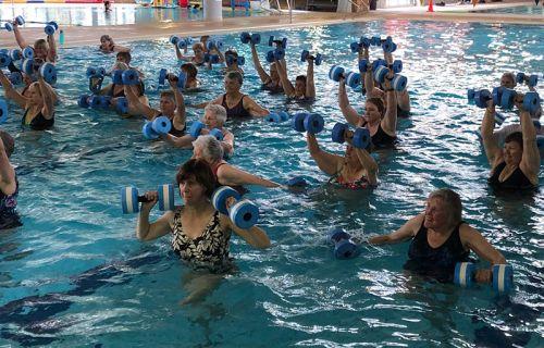 Seniors attending water aerobics class
